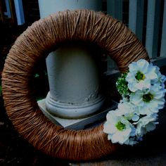 Spring wreath! Wrap a styrofoam wreath with twine, and pinned the flowers on so you can change them with the season.