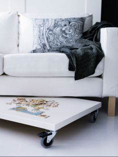 Puzzle table under sofa storage - IKEA Small Space Living, Small Spaces, Couch Storage, Ikea Storage, Smart Storage, Puzzle Storage, Game Storage, Home Decoracion, Small Space Solutions