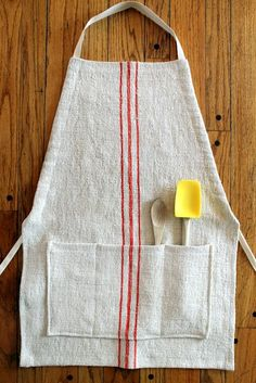 Vintage Grain Sack Apron Adjustable Red Stripes. $65.00, via Etsy.