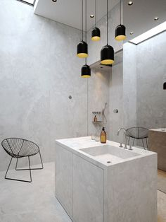 beautiful modern gray bathroom with awesome pendants