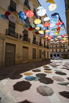 Light, shadows, colors (Umbrella installation by Ingo Maurer in Alicante, Spain) Umbrella Street, Umbrella Art, Oh The Places You'll Go, Places To Travel, Beautiful World, Beautiful Places, Ingo Maurer, Alicante Spain, Beaux Villages