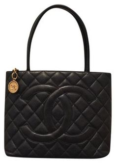 Chanel Medallion Black Tote Bag. Get one of the hottest styles of the season! The Chanel Medallion Black Tote Bag is a top 10 member favorite on Tradesy. Save on yours before they're sold out!