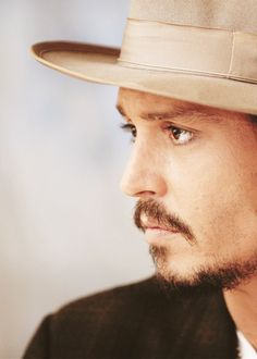 His hats...oh, and those eyes. :).                              ....eye brows, nose, mustache,chin, LIPS, FACE, SKIN.......