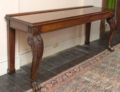 "A WILLIAM IV PERIOD IRISH MAHOGANY SERVING OR SIDE TABLE, the oblong top with a gadroon edge, above a plain freize, raised on heavy leaf carved cabriole legs, each headed with a rosette and terminating in lion paw feet, and paneled pilaster supports, on block feet, 36"" (91cm)h x 88"" (223cm)."