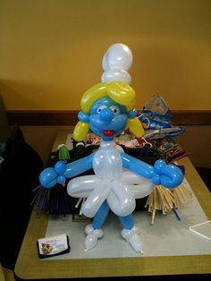 Balloon Twisting Character look a likes Smurfette. Girls just love smurfette. Great for themed parties or events. Photo by The Balloon Bandit of Amusement with a Twist Orlando Florida.