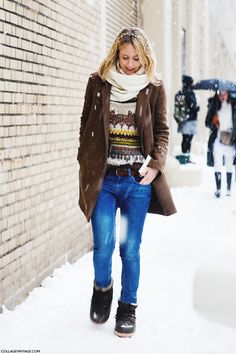 brown coat and jeans