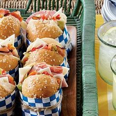 Mini Muffulettas  You can easily make these Mini Muffulettas the day before the party. Just assemble, place in zip-top, plastic freezer bags, and refrigerate overnight. Store-bought craft paper and simple twine create clever sandwich wrappers.~~Tailgate Tip: Prepare sandwiches the day before the game. Place in zip-top plastic freezer bags, and refrigerate overnight.