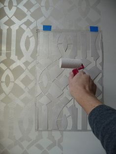 stencil -- this is elegant and very in!  Wallpaper is back full force and this looks much like it.  Do it yourself...more time,but less $
