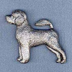 Portuguese Water Dog Pin by George Harris. $9.95. Made with surprising detail, each Portuguese Water Dog pin is perfect for men and women. Cast from pewter, a jewelry metal which maintains its antiqued look, and secured with two push-on clasps to prevent rotation, these Portuguese Water Dog pins make a great decoration for your jacket, vest, hat, lapel, etc. A great collectible or makes a nice gift for dog enthusiasts. Approximate size on the Portuguese Water Do...