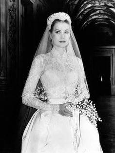 The dress designed by Helen Rose and worn by Grace Kelly for her wedding to Prince Rainer III of Monaco in 1956 is thought of as one of the most iconic bridal gowns of all time. Royal Brides, Royal Weddings, Lace Weddings, Royal Wedding Gowns, Helen Rose, Celebrity Wedding Dresses, Celebrity Weddings, 1960s Wedding Dresses, Famous Wedding Dresses