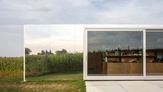 TOOP Architectuur has designed two mobile architecture studios for its staff made of repurposed shipping containers clad in mirrors and timber. Mobile Architecture, British Architecture, Shipping Container Office, Shipping Containers, House Tweaking, Patio Wall, Glass Facades, Shed Plans, Art Design