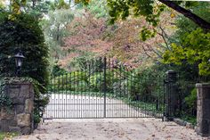 We gave this driveway gate a distinctive pointed arch, which gives the iron gates a totally unique look. Tri State Gate is an automated driveway gate company located in Westchester County, New York. Wrought Iron Driveway Gates, Gates Driveway, Iron Gates, Entrance Gates, House Entrance, Bedford Hills, Wooden Gates, Westchester County