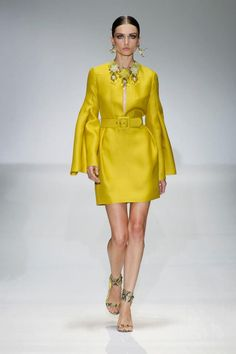 Up your style quotient this spring with the season's most effusive shade: yellow. Flirty dresses, crisp shorts and sleek accessories in citrus tones are like a ray of sunshine for your wardrobe. By Gucci.