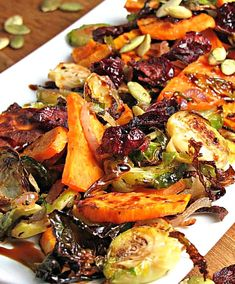 Roasted Brussels Sprouts and Sweet Potatoes blended with dried cranberries and pumpkin seeds and drizzled with balsamic glaze. Brussel Sprouts And Sweet Potato Recipe, Sprouting Sweet Potatoes, Cubed Sweet Potatoes, Roasted Sweet Potatoes, Recipes With Sweet Potatoes, Caramelized Brussel Sprouts, Sweet Potato Recipes Healthy, Healthy Food, Yummy Food