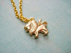 Lion Necklace  Matte Gold Plated Plastic by iceblues on Etsy, $14.00