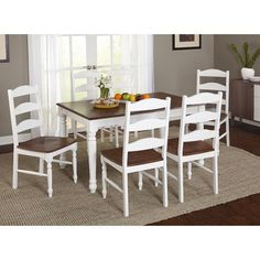 The Elegance Of The Turned Leg Exemplifies Style With The Fleurance Dining  Table And Chairs.
