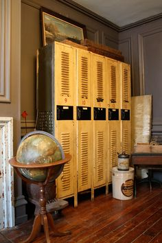 Love this colourful yellow vintage industrial lockers. Bringing vibrant color to a more traditional scheme