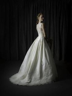 Judd Waddell Constance is a timeless, ball gown featuring a sheer alencon lace bodice, buttons down the back of the bodice and a natural waist. The beautiful silk taffeta skirt has a deep alencon lace hem that flows into the chapel train. This gown came from a designer bridal boutique and is in excellent condition. Judd Waddell Constance is Ivory and a size 12.