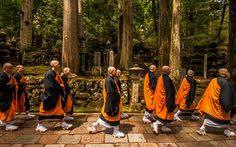 On Koya Mountain - Buddhist monks make their way through the ancient graveyard on Koyasan.
