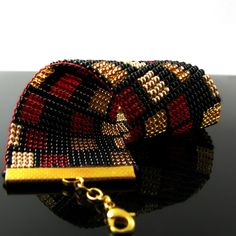 Bead loomed cuff with rectangle pattern by CatsWire.deviantart.com on @deviantART