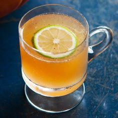 The ultimate bubbly fall punch, best served in a pumpkin punch bowl.