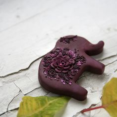 Kni.Kni - Blooming Plum Polymer clay elephant brooch with detailed tiny flowers and leaves.