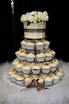 Cupcake tower with beautiful cake on top