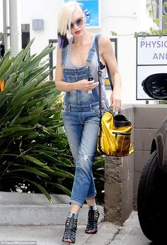 Style jean-ius: Gwen Stefani looked fantastic in a pair of denim dungarees after a nail salon session in Los Angeles on Monday