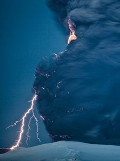 National Geographic - Iceland Vocano Pictures: Lightning Adds Flash to Ash. Intense lightning storms mixed with ash clouds to electrify the night sky over Iceland's Eyjafjallajökull volcano in April 2010