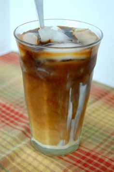Easy iced coffee concentrate recipe from Happy Simple Living, decadent with sweetened condensed milk and a splash of half and half.