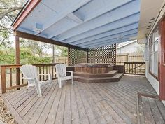Covered patio and deck with amazing hot tub and seating area!