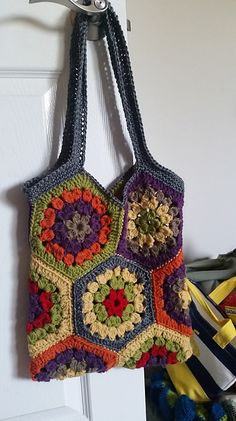 Crochet each of these hexagons in colorful Kitchen Cotton and seam them together to form this cute, trendy bag. The finished project is perfect for summer vacations and beach trips. (Lion Brand Yarn)