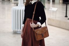 sweaters, black, crisp collars, brown, a leather bag :D