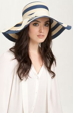 Love the drama with this hat, but maybe it's a bit too much.