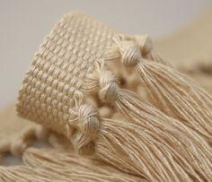 Knotted fringe in spun viscose