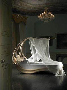 Joseph Walsh designer, gorgeous bed that is a cross between a tree bed, a boat, and a canopy fairy tale cradle.