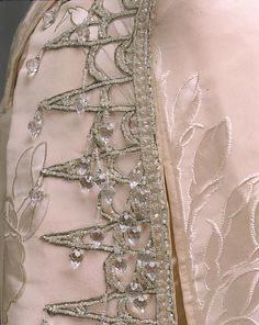 Ball gown Ball gown  House of Worth  (French, 1858–1956)  Designer: Jean-Philippe Worth (French, 1856–1926) Date: ca. 1892 Culture: French Medium: silk, crystal. Detail