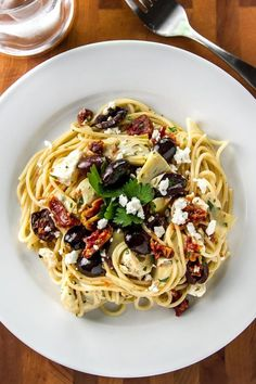 quick and easy pasta dish with olives, artichoke hearts, sundried tomatoes, and creamy feta cheese - on the table in 15 minutes! Mediterranean Pasta, Mediterranean Diet Recipes, Healthy Dinner Recipes, Vegetarian Recipes, Cooking Recipes, Meal Recipes, Vegetarian Comfort Food, Cooking Pasta, Vegetable Recipes