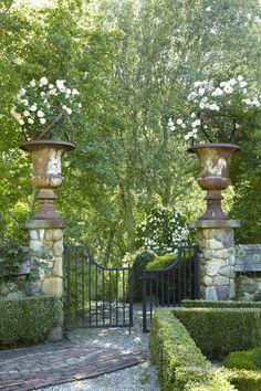 Urns adorn a formal garden entrance