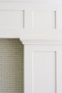 shaker style moulding, tile firebox.  Like this a lot.  Would love it if the cabinets could be like this too.