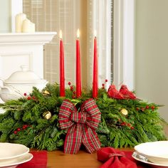 Magnificent Christmas centerpieces table decor evergreen branches christmas ornaments bells red candles