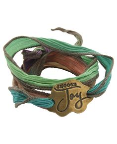 Inspirational wrap bracelet made of hand dyed silk and reclaimed bronze. Eco-friendly jewelry available at BuddhaGroove.com.