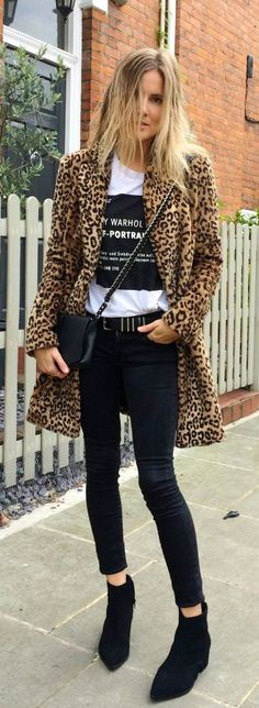 Lucy Williams is wearing a leopard print coat from Mango, black jeans from Frame, black boots from Aldo, T-shirt from Self-Portrait and the Bag is from Rag & Bone