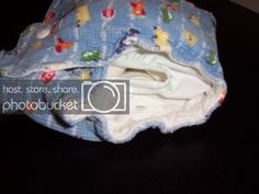 In this tutorial we are going to make a g-diaper style waterproof pouch with snap in tabs. G Diapers, Pouch, Porch, Hip Bag