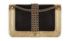 Chanel Pochette en cuir noir et métal doré http://www.vogue.fr/mode/shopping/diaporama/daft-punk-come-back-single-get-lucky-album-random-access-memories-inspiration-accessoires-casques-platines/12947/image/748511#!chanel-pochette-en-cuir-noir-et-metal-dore