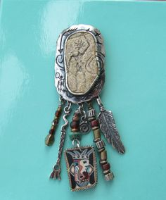 Southwestern sterling brooch with dangling feathers by lolatrail, $18.00