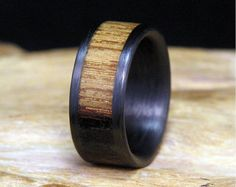 This ring pairs two materials that seem to be meant for one another: whiskey barrel oak and naturally shed deer antler. The oak comes from a well used whiskey barrel and the deer antler comes from...well...a deer, but it was shed naturally! Both materials are supported by a carbon fiber lining, which has literally been built as a sturdy support around them. The materials are finished with a smooth oil bath so they retain their natural look and feel. This layout of the ring can easily be…