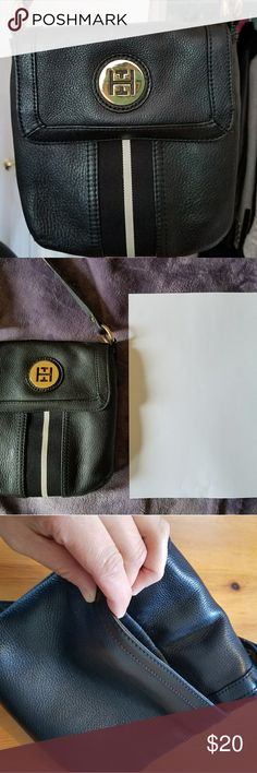 Tommy Hilfiger black leather crossover bag Tommy Hilfiger black leather crossover bag. Slightly used but in great condition! No tears, no marks, no holes. Good size for carrying a small wallet, phone, and keys. Back pouch. Two small pockets inside the bag. Very comfortable for daily use. Feel free to ask for more info. Tommy Hilfiger Bags Crossbody Bags