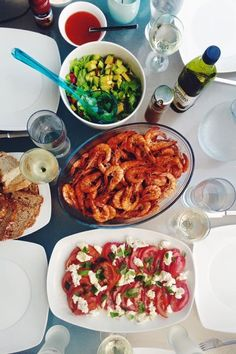 King prawns fried in olive oil with Piri-piri and garlic. Tomato, basil and mozzarella salad and a salsa of tomato, red pepper, red onion and cucumber. Yum!