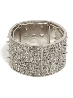 our silver ice urchin cuff is filled with mini spikes that make a big impression